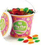 Flip flops gummi candies in a beach pail.