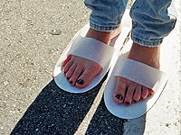 Freshly painted toenails - enhanced by the flimsy disposable footwear!